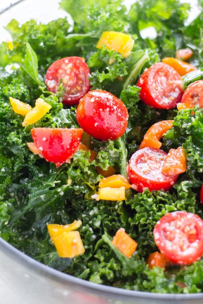 Kale Salad with Cherry Tomatoes with olive oil dressing is a healthy salad recipe! This easy salad includes massaged kale, cherry tomatoes and sweet peppers to make it a gorgeous rainbow salad! This salad is perfect for family dinners and big crowds.