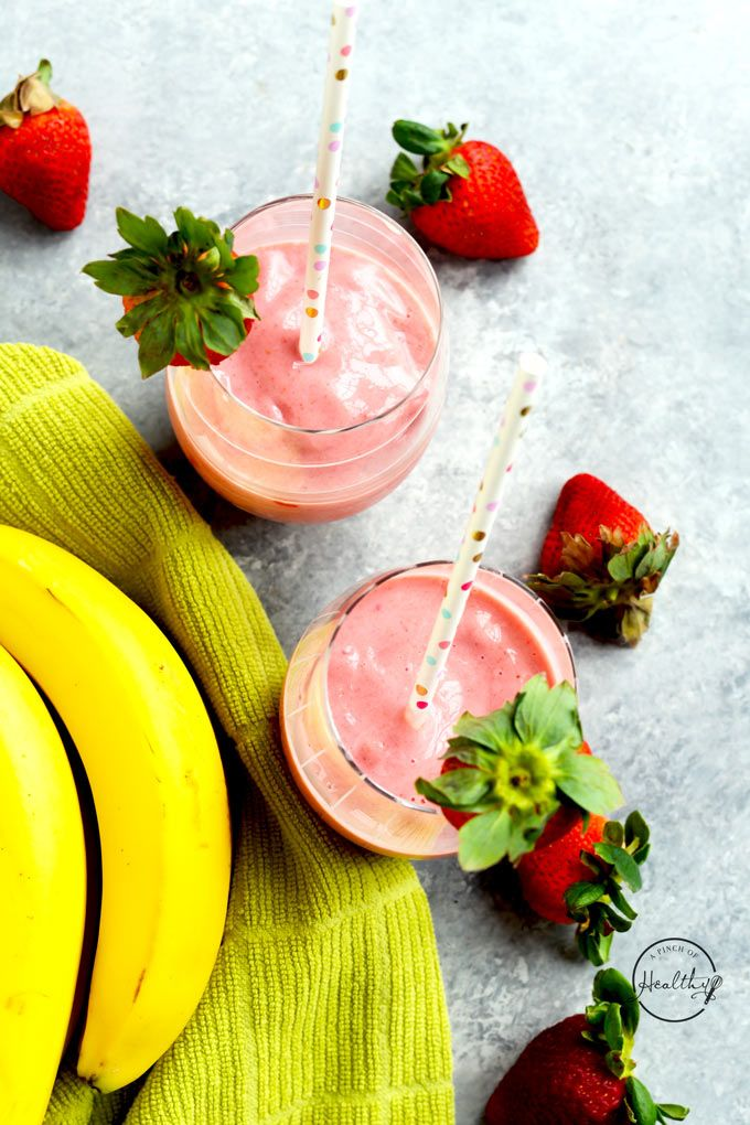 frozen strawberries and a banana in a blender with the lid off